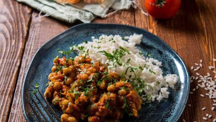 plate of Brazilian rice beans on wood table